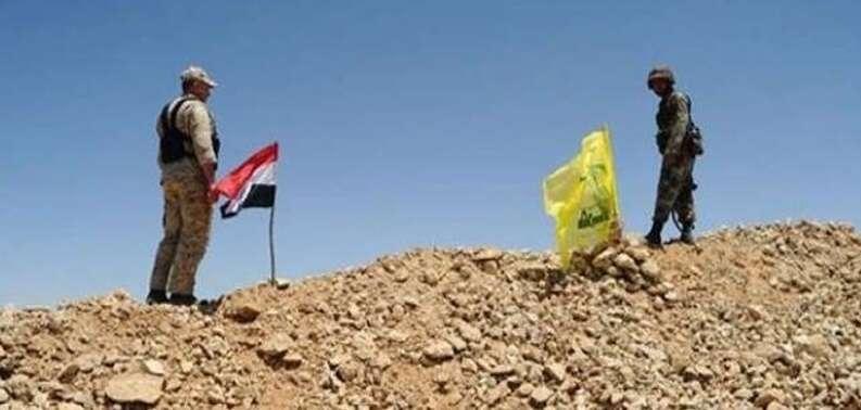 Syrský ozbrojenec abojovník Hizballáhu hlídkují nasyrsko-libanonské hranici. Foto archiv TasminNews.com