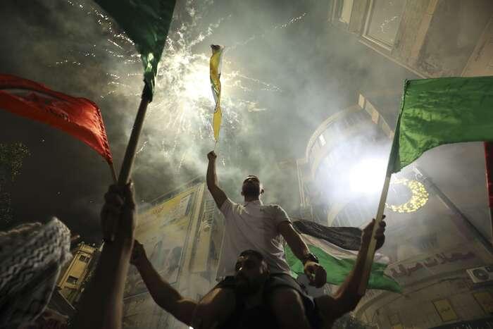 Jako vždy slaví itentokrát obě strany konflikt jako své vítězství. Při jedenáctidenní eskalaci bylo zabito bezmála 250 lidí. Foto Abbas Momani, AFP